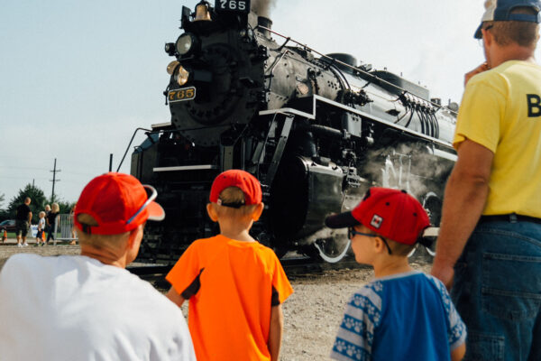 Crowds gathered as the historic steam locomotive No. 765 let out a whistle as it sat on the tracks during the Fort Wayne Railroad Historical Society's open house on Saturday.  The glossy black engine, which was the first locomotive to make its way across Fort Wayne's elevated railroads, had coals stacked high as conductors climbed aboard.