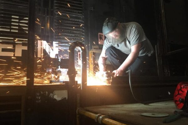 Brandon Willis continues fabrication work on 358's battery boxes.
